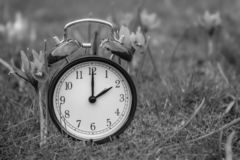 Daylight saving time. Alarm clock switched to summer time. Changing clock from wintertime to summertime. At 2 o`clock at night time is presented for one hour royalty free stock photo