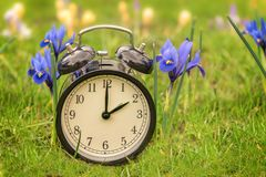 Daylight saving time. Alarm clock switched to summer time stock photo