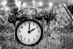Daylight saving time. Alarm clock switched to summer time stock image