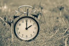 Daylight saving time. Alarm clock switched to summer time stock photos