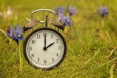 Daylight saving time. Alarm clock switched to summer time. Changing clock from wintertime to summertime. At 2 o`clock at night time is presented for one hour stock photo