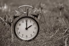 Daylight saving time. Alarm clock switched to summer time. Changing clock from wintertime to summertime. At 2 o`clock at night time is presented for one hour stock photography