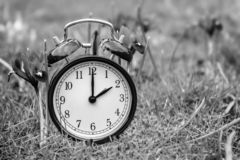 Daylight saving time. Alarm clock switched to summer time royalty free stock photos