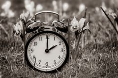 Daylight saving time. Alarm clock switched to summer time stock images