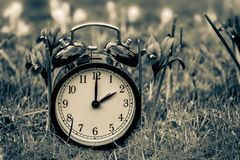 Daylight saving time. Alarm clock switched to summer time. Changing clock from wintertime to summertime. At 2 o`clock at night time is presented for one hour royalty free stock images