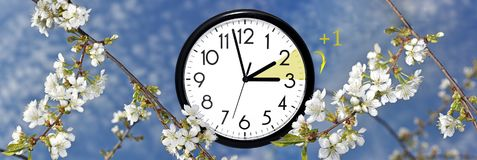 Daylight Saving Time. Change clock to summer time. Daylight Saving Time. DST. Wall Clock going to winter time. Turn time forward. Abstract photo of changing Stock Photos