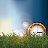 Daylight saving time clock in a field EPS 10 vector Stock Photo