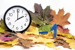 Daylight Saving Time. Wall Clock going to winter time stock photography