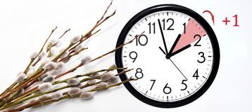Daylight Saving Time. Change clock to summer time. Daylight Saving Time. DST. Wall Clock going to winter time. Turn time forward. Abstract photo of changing royalty free stock photography