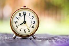 Daylight savings time concept, alarm clock. Daylight savings time, spring forward concept - retro alarm clock royalty free stock photos