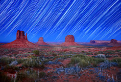 Daylight and Star Trail Image of Monument Valley Stock Photos