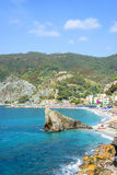 Daylight sunny day view to blue sea, beachline and green mountains Royalty Free Stock Images