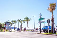 Daylight sunny view to city of french riviera with people crossing street. NICE COTE D`AZUR, FRANCE - JUNE 29,2017: Daylight sunny view to city of french riviera stock image