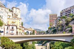 Daylight sunny view to Monaco city bridge, buildings and mountai. Ns in France. Bright sky with a few clouds Royalty Free Stock Photo