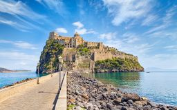 Daylight view of Aragonese Castle near Ischia island, Italy Stock Photos