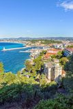 Daylight view to beachline and blue sea of Antibes, France Stock Images