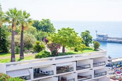 Daylight view to green garden full of trees and bushes above apa. Rtments near port. Bright clear sky in a sunny day. Monaco, France Royalty Free Stock Image