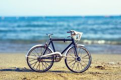 Daylight view to handicraft bicycle souvenir on sand royalty free stock photos