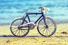 Daylight view to handicraft bicycle souvenir on sand stock image