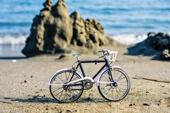 Daylight view to handicraft bicycle souvenir on sand stock photos