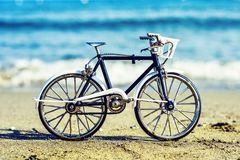 Daylight view to handicraft bicycle souvenir on sand royalty free stock images