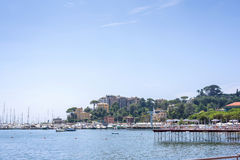 Daylight view to mountains, blue sea, beach pier and city of Rap Stock Photo