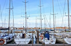 Daylight view to parked sailing boats in a little port facing Ri royalty free stock photo
