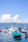 Daylight view to ships cruising on water near Portofino city. In Italy Stock Images