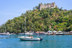 Daylight view to ships cruising on water near Portofino city. PORTOFINO, ITALY - JUNE 26, 2017: Daylight view to ships cruising on water near Portofino city in Royalty Free Stock Photo