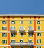Daylight view to vibrant Mediterranean colorful yellow building facade in Milan, Lombardy, Italy. Daylight view to vibrant Mediterranean colorful yellow Stock Photography