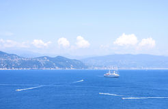 Daylight view from top to ships cruising on water near Portofino city. In Italy Royalty Free Stock Photos