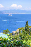 Daylight view from top to ships cruising on water near Portofino city. In Italy Stock Images