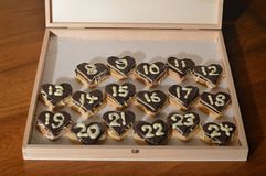 Christmas countdown – Advent calendar 8th dec. 17 days until Christmas Eve: the 6th of December - sweet hearts Advent calendar with 24 chocolate marzipan royalty free stock image