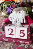 25 days until Christmas. Santa Claus holding 25 days until Christmas decoration blocks royalty free stock photography