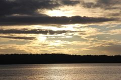 Days End at Seahurst Park Beach. The days end sunset at Seahurst Park Beach in Burien, WA. September royalty free stock photos