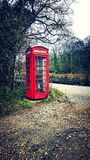 Days gone by. Old style British telephone box Stock Photos