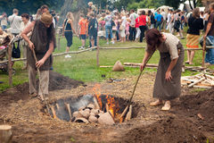Days of Live Archaeology. KERNAVE, LITHUANIA - JULY 5: Visitors and craftsmen at 11th International Festival of Experimental Archaeology Days of Live Archaeology Stock Images