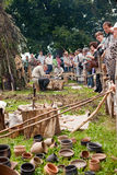 Days of Live Archaeology. Kernave, Lithuania - July 5: Visitors and craftsmen at 11th International Festival of Experimental Archaeology Days of Live Archaeology Royalty Free Stock Photo