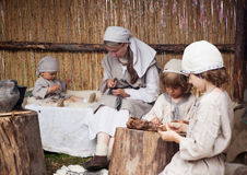 Days of Live Archaeology. Kernave, Lithuania - July 5: Prehistorical family demonstration at 11th International Festival of Experimental Archaeology Days of Live royalty free stock image