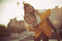 The days are never short of fun when they`re together. Mother and daughter in the city stock image