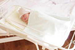 4 days newborn baby girl in maternity hospital. Royalty Free Stock Images