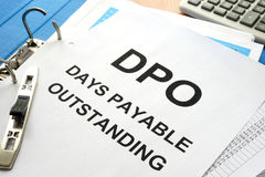 Days payable outstanding DPO. Pile of papers with title Days payable outstanding DPO Royalty Free Stock Photo