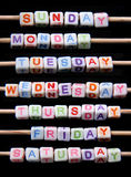 Days of the week. Created with miniature bricks with letter on black background royalty free stock photos