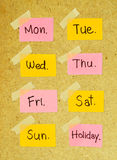 Days of the week note with masking tape. On wood background Royalty Free Stock Photos