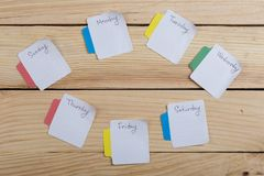The days of the week - the paper stickers attached to the board is. Sticker with monday tuesday wednesday thursday friday saturday sunday, concept, background royalty free stock images