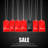 Days of the week symbols and black friday promotions on red hanging labels Royalty Free Stock Photography