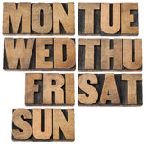 Days of week in wood type. 7 days of week (first 3 letter symbols) in isolated vintagewood letterpress printing blocks royalty free stock photos