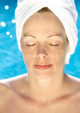 Dayspa. Woman wearing towel at swimming pool Royalty Free Stock Photos
