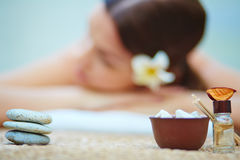 Dayspa. Close-up of aromatic oil, salt and sticks Royalty Free Stock Photo