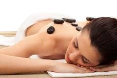 Dayspa, concept. Young woman getting a stone massage at spa salon Royalty Free Stock Photos